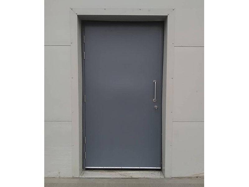 Grey fire resistant steel door