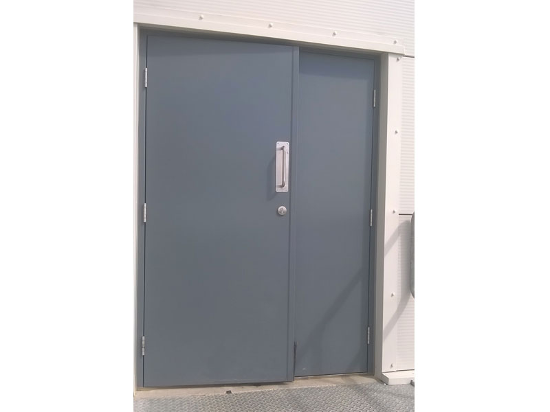 Grey steel double security doors
