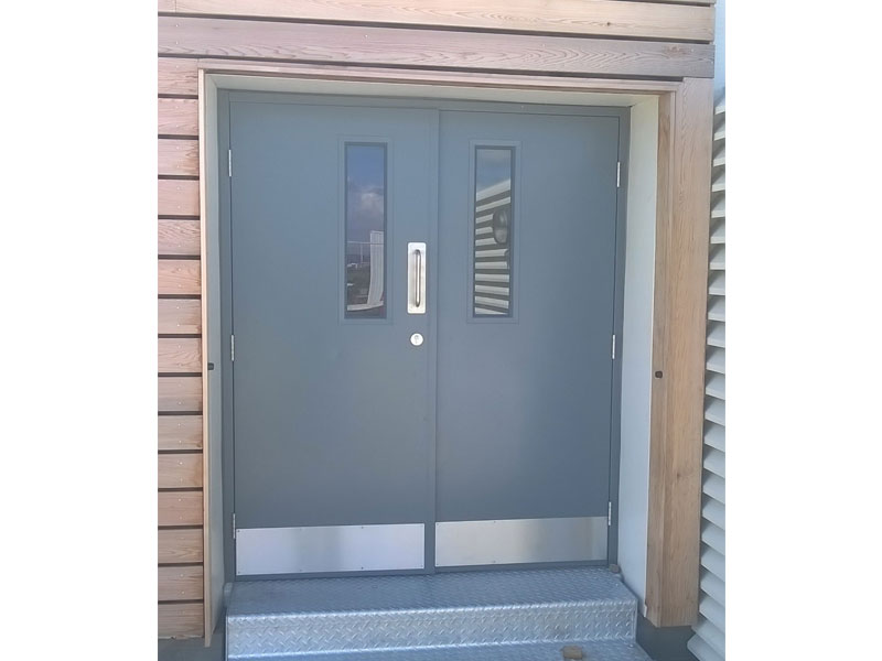 Closed pair of steel security doors
