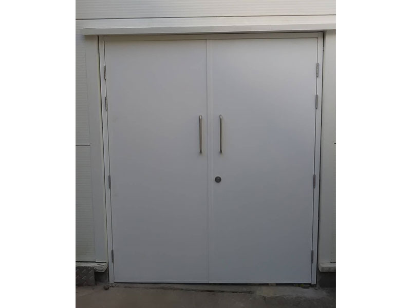 Closed white industrial steel doors