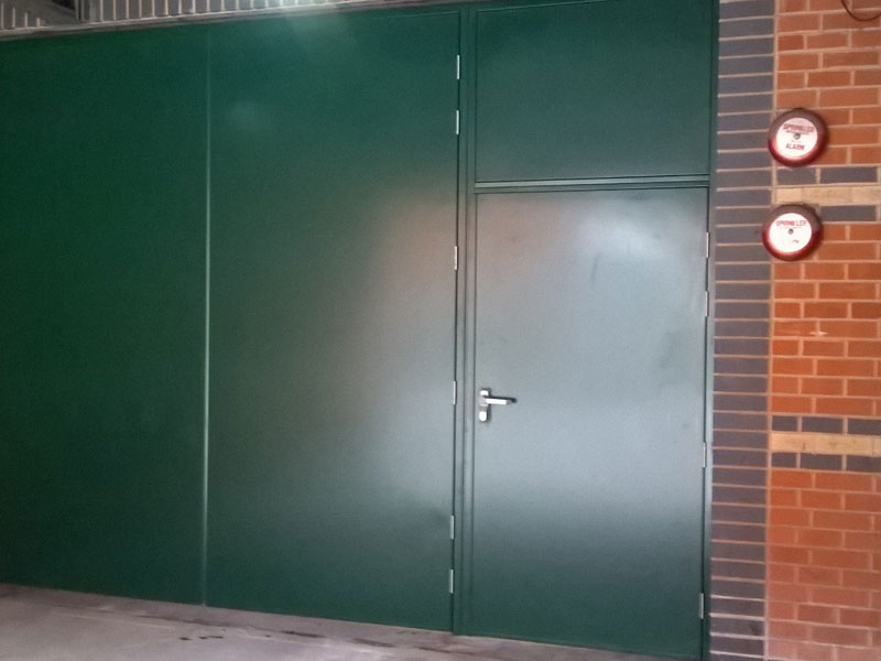 Meadowhall project - green steel industrial door installation