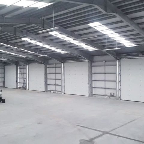 White industrial doors in empty warehouse
