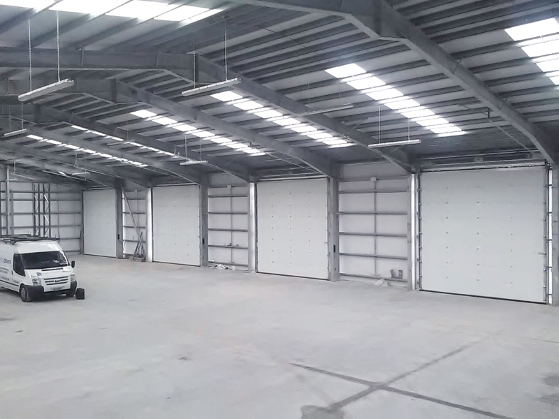 White industrial doors in empty warehouse