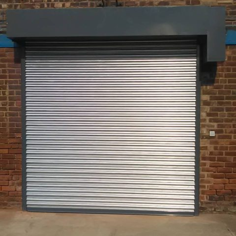 Roller shutter with canopy