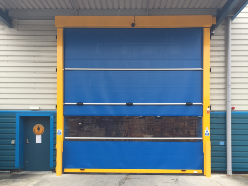 Blue high speed door installed with a yellow surround