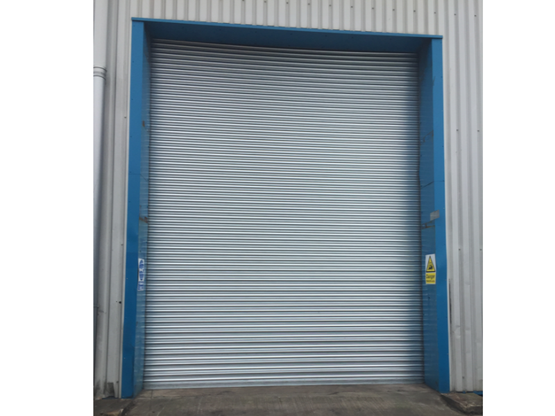 Silver roller shutter door with blue surround