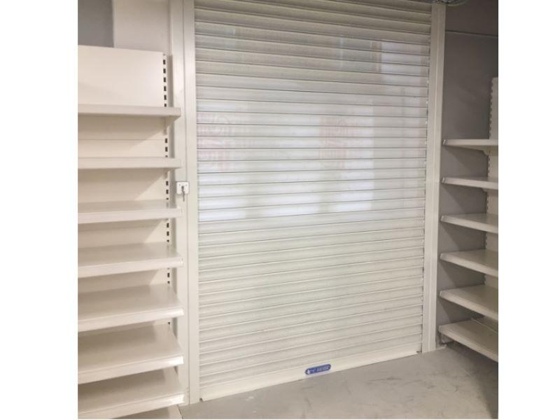 White retail roller shutter