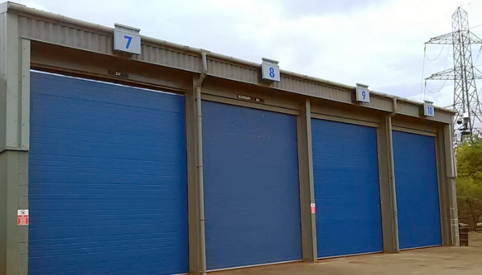 A line of blue commercial garage doors